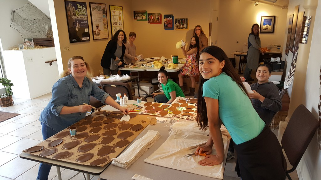 Volunteers of all ages help to create costumes for the upcoming production of Disney's Lion King KIDS.